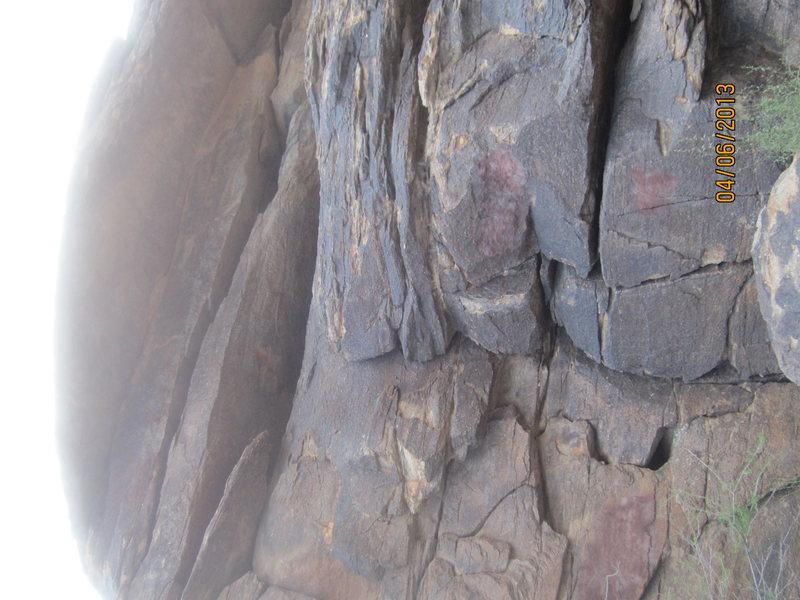Climb corner crack, top out left.