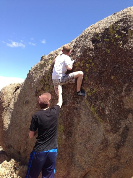 Rock Climbing Photo: Getting spotted while his foot's jammed in the cra...