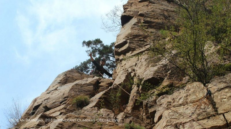 """RyderS reaches the first belay station on """"Weibo Paprazzi"""" during the route's FA."""
