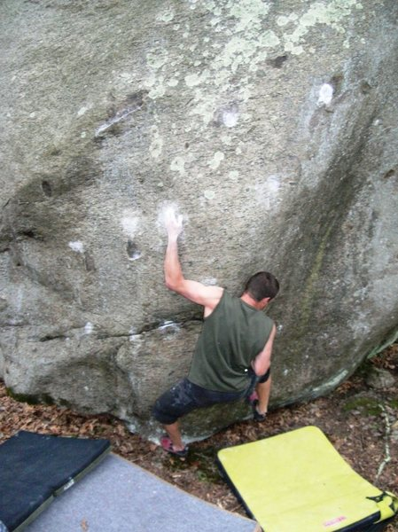 Mike Galoob cranking on the Broke Moon boulder.