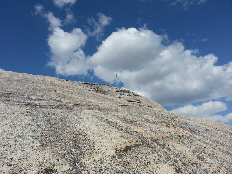 Wandering up the 4th class slabs spanning the end of the 8th pitch to the summit of half dome, April 24, 2013.  You're probably tired after a long day of approach hiking and fast climbing, so don't forget to rest and be careful!