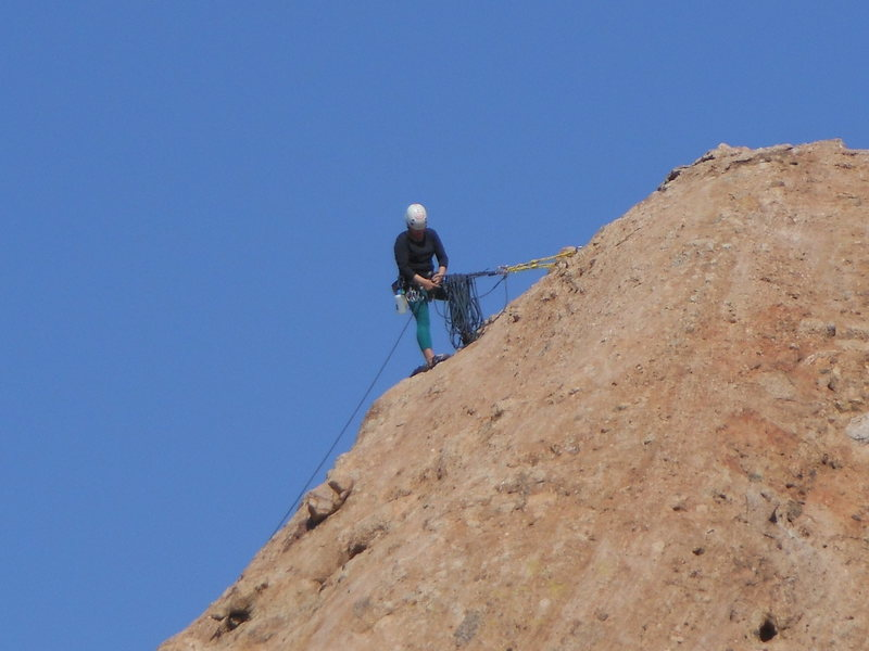 """A leader belaying from the P2 anchor on """"Goldline."""""""
