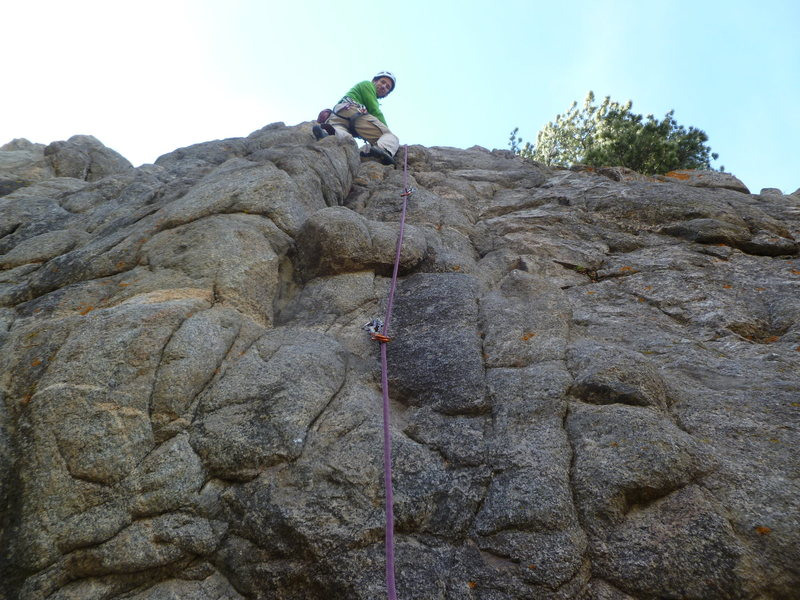 Near the top, the crux is at the first bolt.