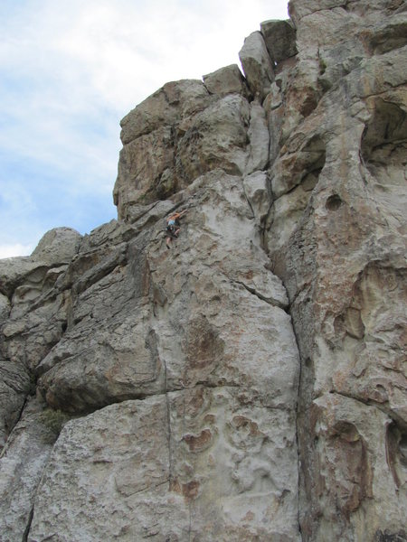 Crack/corner system to climber's right is Private Idaho; climber is about even with the crux.