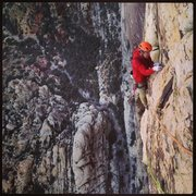 Rock Climbing Photo: Andy Hansen cleaning up the exposed last pitch of ...