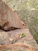 Rock Climbing Photo: Hansen cleaning up the thin face traverse pitch on...