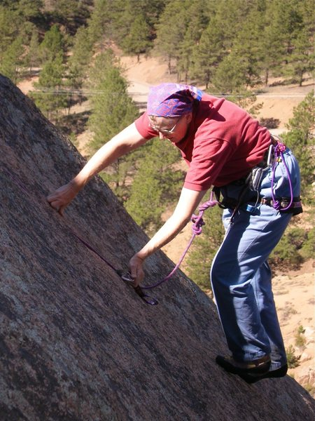 Rock Climbing Photo: Unclipping one of the old bolts.