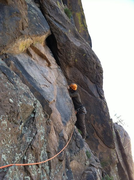 Our mini pitch 2.  We stopped P1 on a nice ledge, then made an easy traverse out right to this wide section.  A #5 would be nice here, but a few 5.6 moves up and you can place a #3 or 4 deep.  Just above you'll find another comfy stance to belay below the splitter 2nd pitch proper.