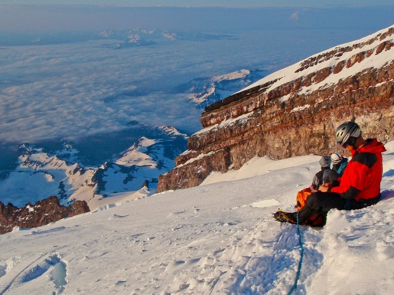 Taking a quick break high on the Ingraham Glacier as the sun comes up.