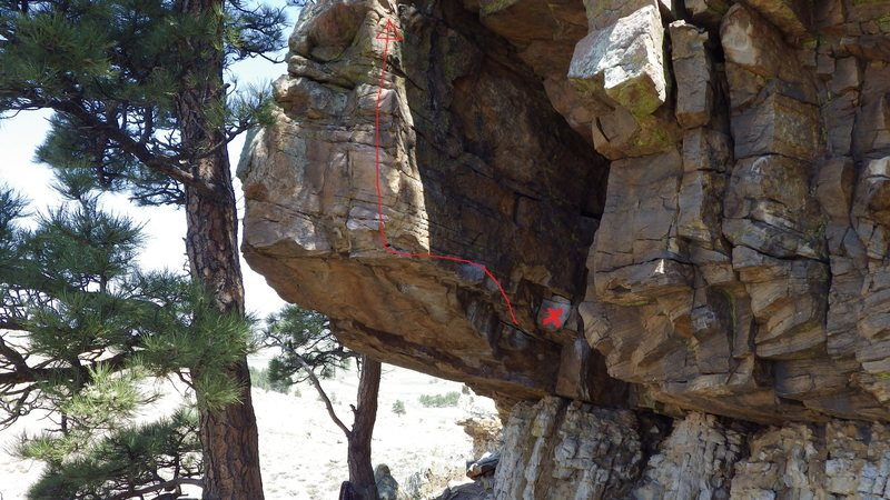 Start in the crack and follow big moves around to the face of the overhang. Get your feet set and continue up the face on good holds.
