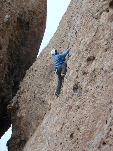 "A climber enjoying the stellar pockets on ""Sophie's Choice."""