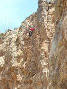 Rock Climbing Photo: In the middle of the crux on the redpoint.  Photo ...