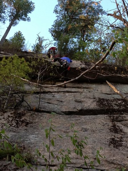 Climber pulling the roof on Coyote Rain, 5.6