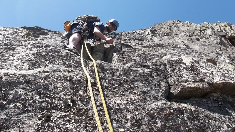 Mike putting gear after the twelve foot very lichen covered crux.