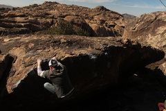 Rock Climbing Photo: Beautiful Hueco. Topping out Hector