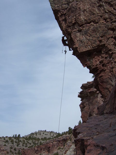 Dingus McGee working the steep rock on the prow.