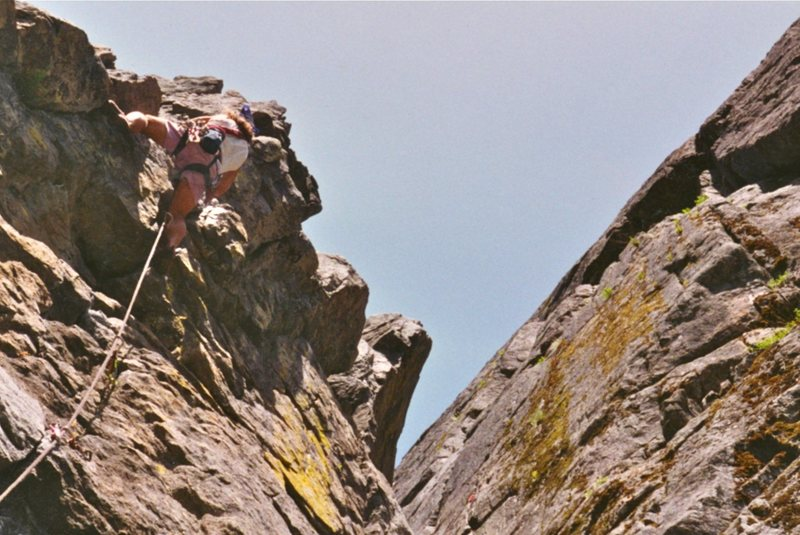Phil Gleason at the crux, South Face Jello Tower, 5.8+, 1999.