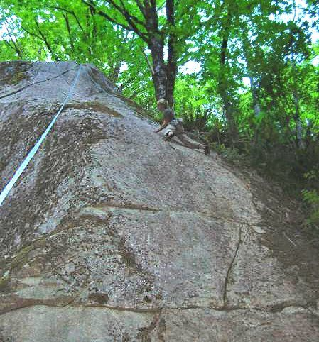 Climber toproping Weed-be-gone (10b). The upper part of A Touch too Much (11b) crosses the image in the upper left. (Photo from RCNW.net)