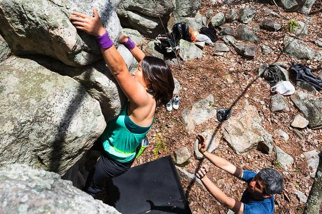 Zoey working a left side variation on the Orb that uses the horizontal chip/flake above the roof-bulge for a right hand hold. Goes at about V2, IMO. <br> <br> Photo by Katie Lepak