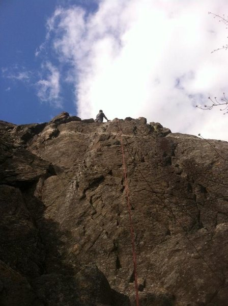 Kyle standing by the anchors at the top of the micro crag after climbing one of the many variations.