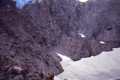 Rock Climbing Photo: Traversing the snowfield below the east face of Ka...