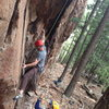 Me working a short cruxy top rope problem (probably 11+) just left of Reef on It, in Tan Corridor.