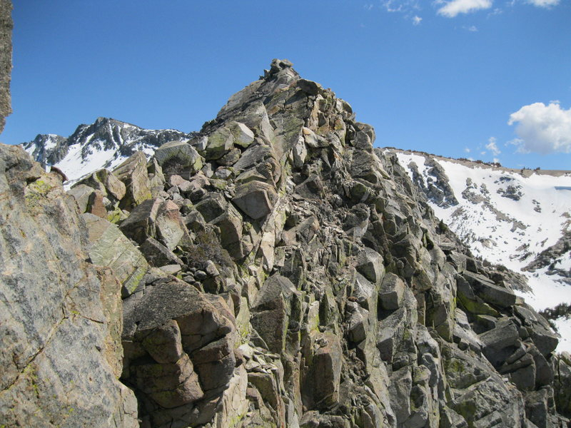 Top of North Arete route looking over to the true summit.
