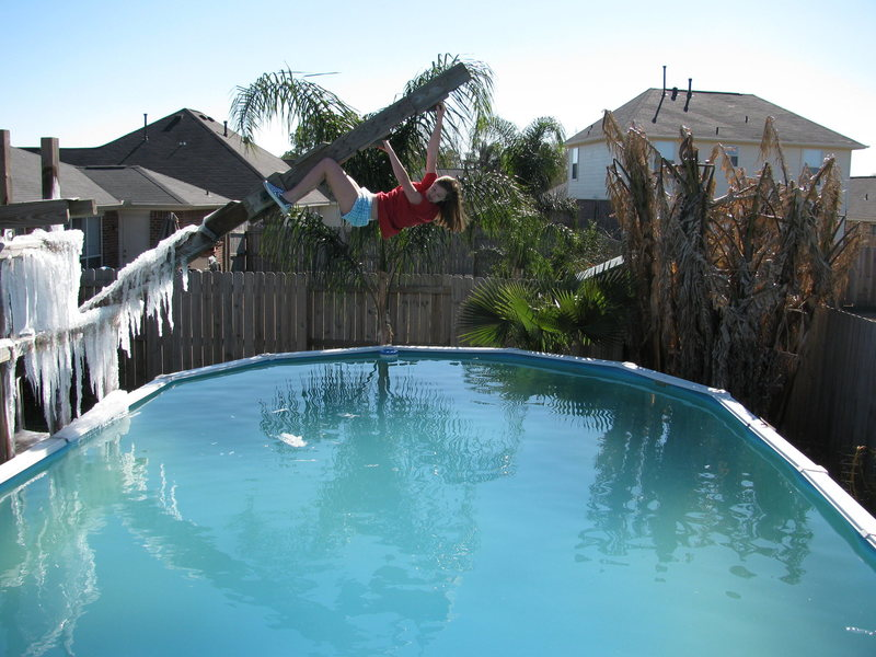 Leadon Meneke on a deep water solo in my back yard.  Note the hanging ice on the left side.