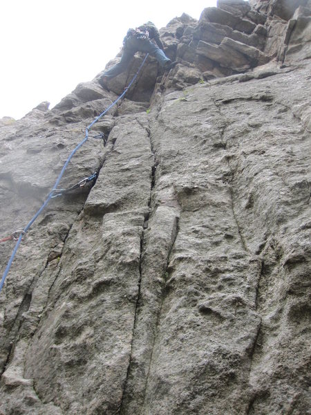 At the crux overhang where you will find the lone bolt above the lip.