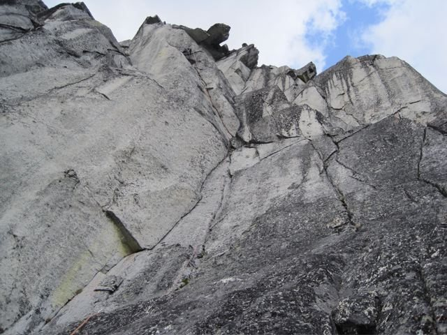 overlap crux. (climber is hard to see high on the route just below the left side of the cobra)