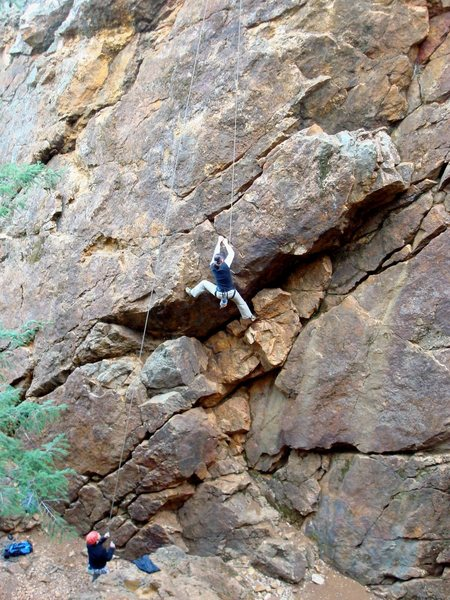 Cheri Ermshar climbing Overhang 5.9. Photo by Floyd Hayes.