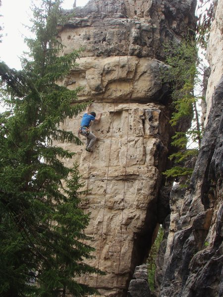 Laid Back, 5.11c<br> This is the middle route on the blonde side of a free standing pillar in The Shadowlands.<br> <br> Spearfish Canyon, South Dakota.