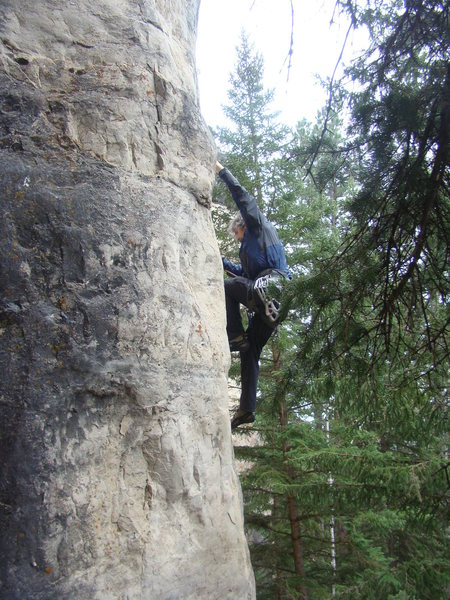 Jerry tugging as hard as he can to get up Tug Life, 512a.<br> <br> The Slim Shady Pillar Area deep within The Shadowlands Crag.<br> <br> Spearfish Canyon, SD.