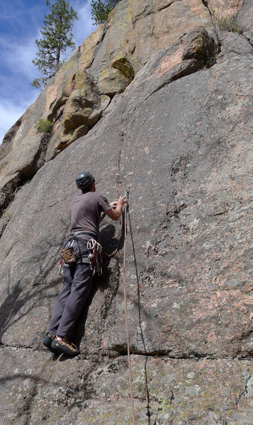 Climber starting up Crystal Corner.
