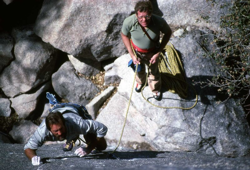 Eddie Bebout leading 5.10 slab, John Stannard - belay c.1988. The place that cannot be mentioned (it's seekrit!) B.C. Mexico.