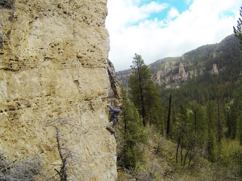 Jerry on Yippie-Kay-Yay, 5.10b.<br> A classic climb found in The Lady In Red crag of the Mohican Wall.<br> Spearfish Canyon, SD.