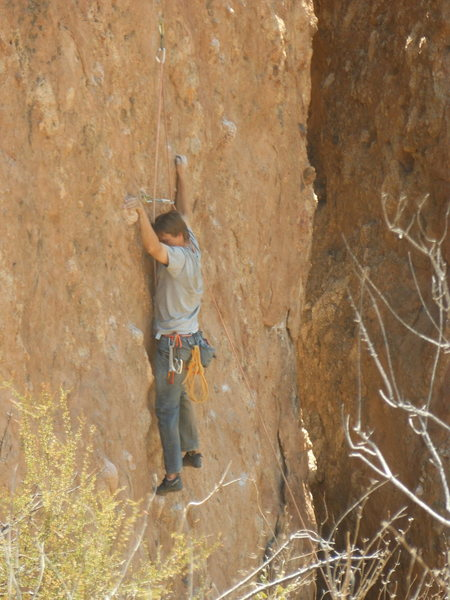 A climber working the line on the left or the east wall of Corvus Crack.