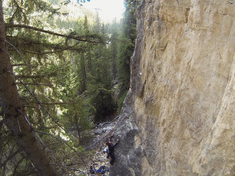 Harrison is about to Hash It Out, 5.10b/c<br> <br> Half Baked Wall, The Danks.<br> Spearfish Canyon, SD.