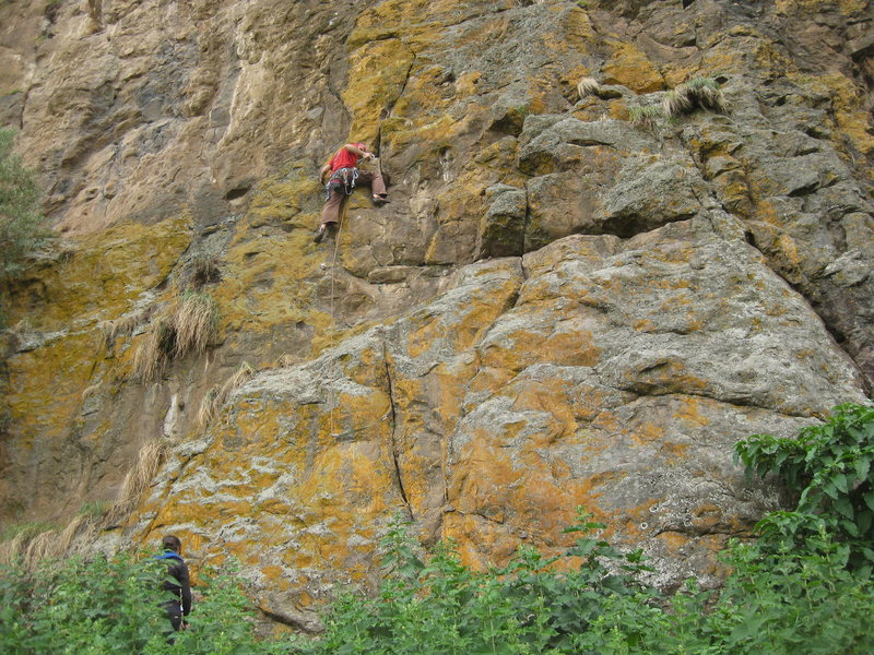 The climb starts below the climber in the obvious finger crack.