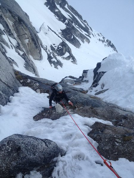Adrienne Kentner climbing in early season mixed conditions on the 3rd pitch of the South Face.
