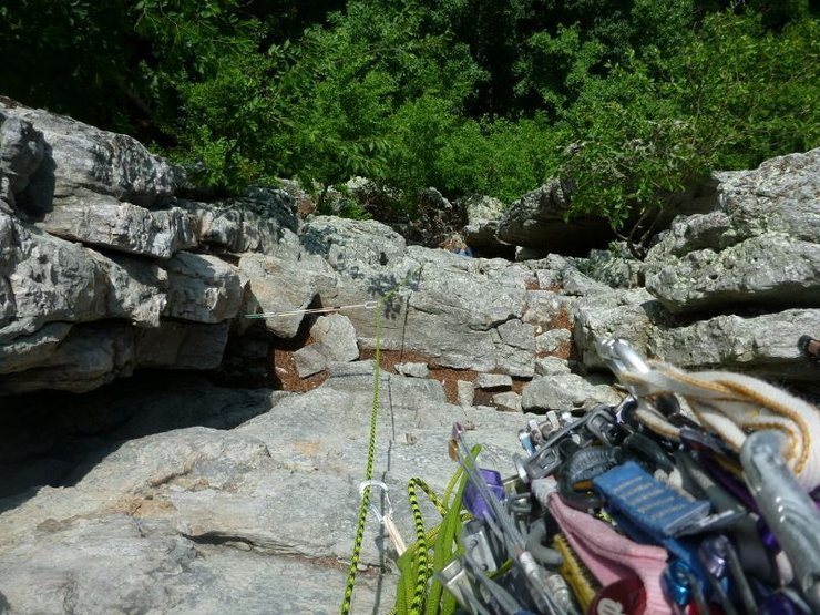 Paul Deagle on the hanging belay at bolts