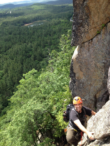 Christopher Lane reaching the belay on Pitch 2