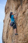 Rock Climbing Photo: Lena works up to the final crux on Mighty Quinn (1...