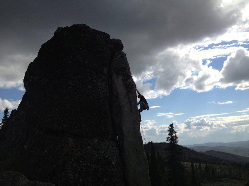 John Harley climbing The Fin 5.11