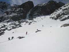 A group of climbers makes their wat up Huntingtons Ravine, Pinnacle Gully in the background 2011