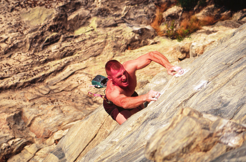 Seth Tart powering through the crux of Season in Hell<br> Photo by Chris Huffine