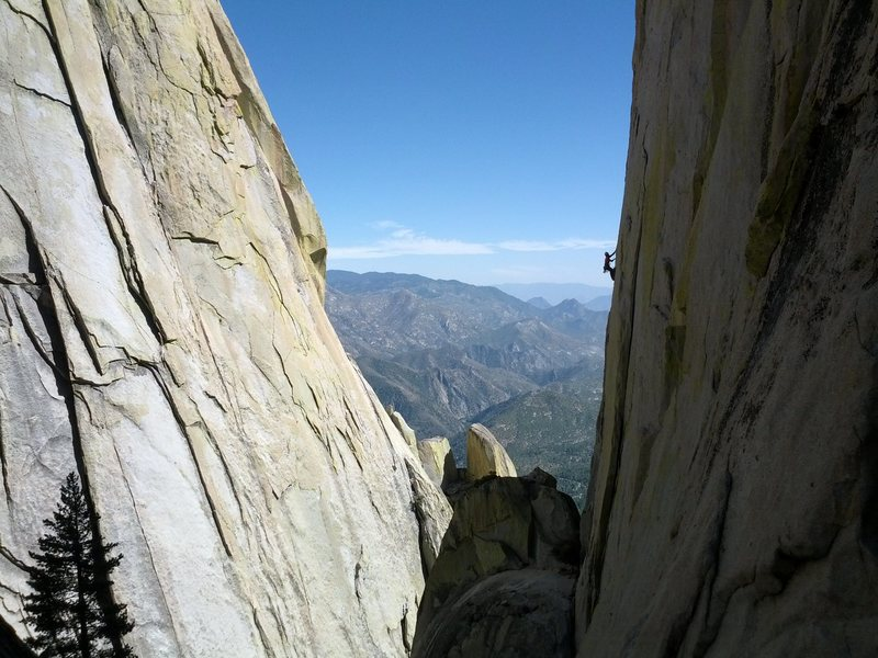 A climber on Thin Ice on The Sorcerer. Needles, Southern Sierra.