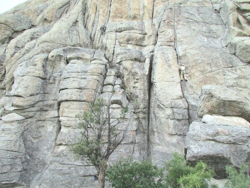 Climbers on Carol's Crack (L) and Adolescent Homo (R).