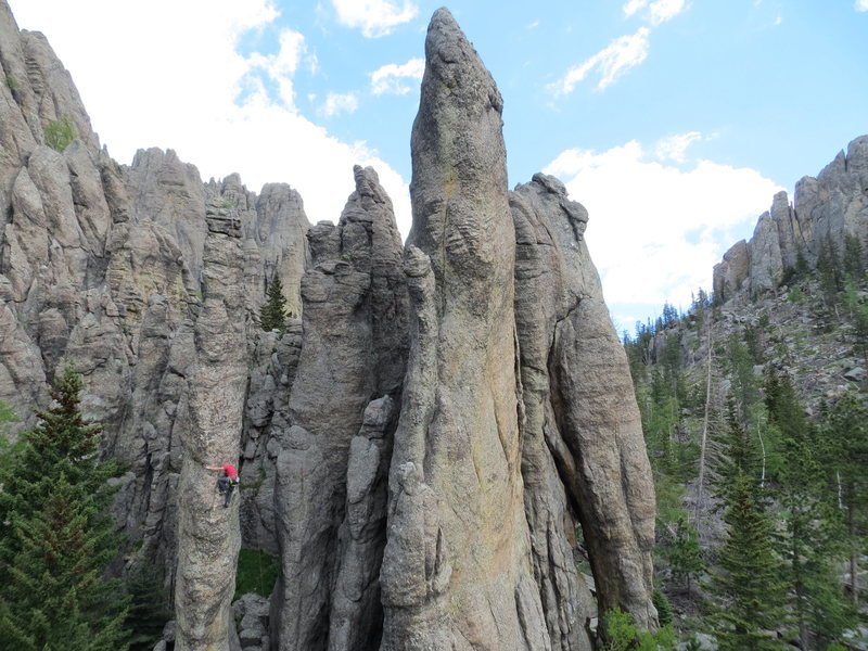 Bob Prann on Freak's Fright. Freak's Foot is the tall center spire with Flying Buttress right behind.