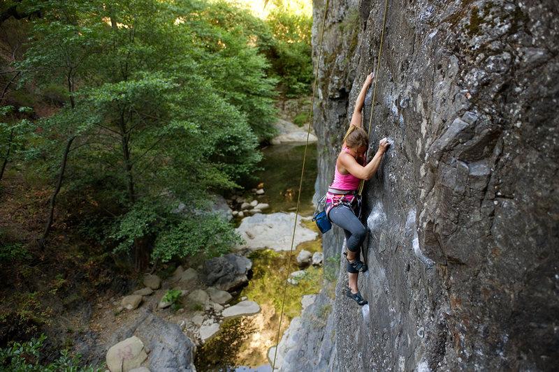 Katie climbs Danger Boy (5.11a), at Wheeler Gorge.